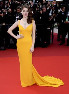 Anna Kendrick hit the 'Cafe Society' premiere red carpet in a vibrant marigold gown.