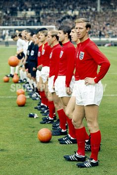 30/7/1966 Football World Cup Final 1966.<br />West Germany v England.<br />Jack Charlton looks over his shoulder as the teams line up for the national anthems prior to kick off.<br />