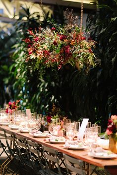 Gorgeous and lush Millwick Wedding Reception Tablescape in DTLA with wild hanging flower installations and table design. Burgundy and pink flowers. Planning & Design, Art & Soul Events
