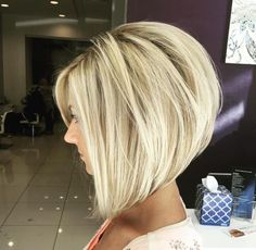 Stacked, layered bob with bangs framing the face-- short in the back, long in the front. The color is stunning too.