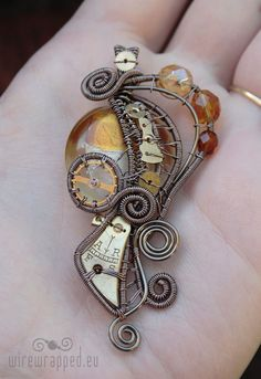 Usually not a fan of steam punk wire wrapping, but this is actually really beautiful.