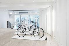 Biomega's Sleek New Bike Store Opens in Copenhagen Scooter Store, Bicycle Store, Window Display Retail, Window Displays, Retail Store Design, Retail Stores, Bike Room, Visual Merchandising Displays, Bicycle Brands