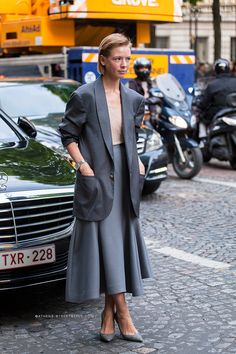 Make a midi skirt work with a long blazer by tucking in your blouse and wearing pumps.