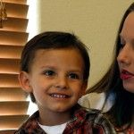 Landon Riddle, 4, is held by his mother, Sierra Riddle, this past April at their home in Colorado Springs, where they moved so that Landon c...