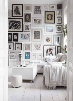 gallery wall... Saw one on a design show with blue gray paint, all white and same size frames with black and white pictures!! love!