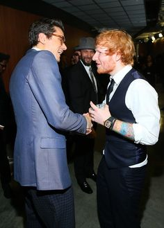"""""""Great job up there."""" John Mayer and Ed Sheeran have a bro moment backstage following their performance of """"Thinking Out Loud"""" at the 57th Annual GRAMMY Awards on Feb. 8, 2015, in Los Angeles"""