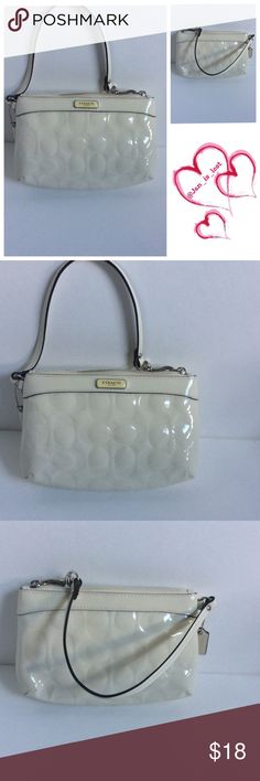 """SPRING CLEARANCE Coach Wristlet Carried this a few times but no longer can hold my new cellphone. Does has spots on it, I tried cleaning it and was unable to remove them so this has been priced accordingly. Measures 5"""" tall by 7 1/2"""" in length and 1 1/2"""" in depth. Coach Bags Clutches & Wristlets"""