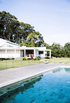 The pool is surrounded by the same red ironbark hardwood decking as the outdoor living area, but sun exposure has turned it silver Weatherboard House, Modern Farmhouse Exterior, Plunge Pool, River House, Outdoor Living Areas, House Goals, Pool Designs, Backyard, Mansions