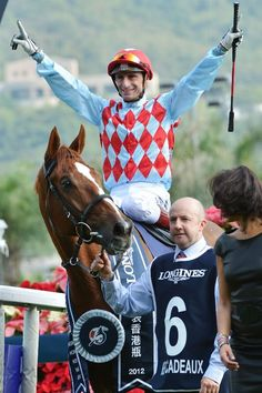Gerald Mosse aboard Red Cadeaux celebrates after winning The Longines Hong Kong Vase during the Hong Kong International Races at Sha Tin racecourse on December 9, 2012