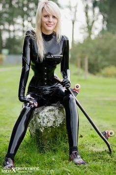 Juli Lolipop in black latex catsuit - surely she can skateboard in ballet boots??