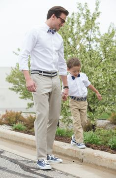 "Your little guy is a chip off the old (stylish) block. Why not get them ""Dad and me"" outfits for Father's Day? On dad: Apt. 9 slim-fit dress shirt, Dockers Signature slim-fit pants, Chaps Alpine checked bow tie and Converse sneakers. On kid: Chaps button-down shirt, bow tie and chinos and Converse sneakers. Find a stylish Father's Day look at Kohl's."