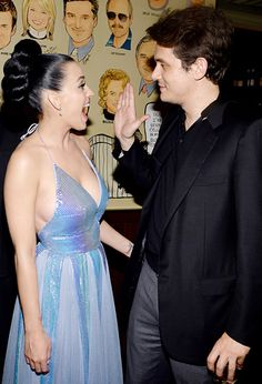 Put 'er there! John Mayer and Katy Perry at a Grammys post-show reception at the Palm