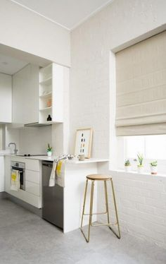 18 Awsome Ideas, Create an Elegant Statement with a White Brick Wall - White brick wall in a modern kitchen area