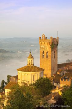 A misty dawn over San Miniato, Tuscany Italy. © Brian Jannsen Photography