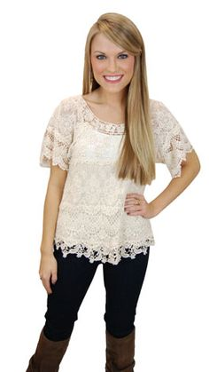 We love the look of a feminine lace blouse with rugged boots! www.shopbluedoor.com