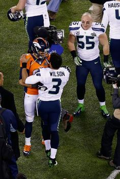 EAST RUTHERFORD, NJ - FEBRUARY 02: Quarterback Russell Wilson #3 of the Seattle Seahawks shakes hands with quarterback Peyton Manning #18 of the Denver Broncos after Super Bowl XLVIII at MetLife Stadium on February 2, 2014 in East Rutherford, New Jersey. The Seahawks beat the Broncos 43-8. (Photo by Jeff Zelevansky/Getty Images)