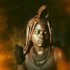 himba girl by Karin Mueller - i took this gorgeous portrait in namibia 2009.   this is a himba girl, living in the kaokoveld.      she invited me in her hut. she is not really sad - they are just not allowed to smile on picture...