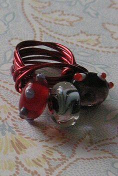 A red fun lampwork ring