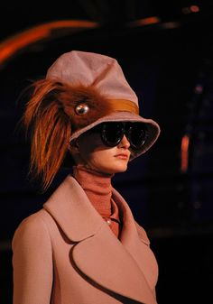 Don't like the shades ..... Love that silly hat ..  via mahala knight