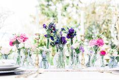 Een heleboel kleurrijke bloemen en vaasjes <3