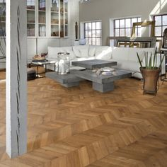 Light brown chevron engineered wood floors. Warm toned chevron wood floor sporting a dramatic pattern effect and occasional knots and cracks.