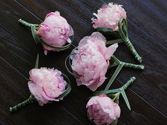 Peony boutonnieres with lily grass by Flowers by Shirley (http://shirleyflowers.blogspot.com).