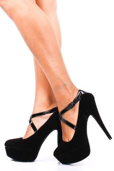 BLACK CRIS CROSS STRAP MARY JANE PUMPS.