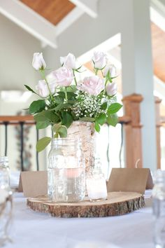 The vases are made of natural birch bark, wrapped over a metal container. It measures 9 tall and has a 4 3/4 opening. This would be a wonderful addition for your wedding tables or home decor!  I used these as part of the centerpieces for my own wedding and people were actually asking to buy them as they left for the night!  Wood burnt initials surrounded by a heart can be added. Just choose the option and PM the initials youd like.