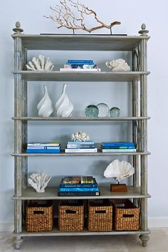 storage baskets in open shelving of etagere