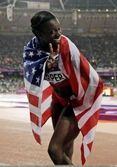 USA's Dawn Harper celebrates her silver medal win in the women's 100-meter hurdles during the athletics in the Olympic Stadium at the 2012 Summer Olympics, London, Tuesday, Aug. 7, 2012.