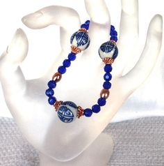 Cobalt Glass, Copper and  Porcelain Beads  Stretch Bracelet by SaraJewelryDesign on Etsy