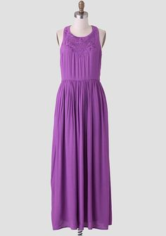 This luxurious, saturated-purple maxi dress is adorned with intricate floral embroidery at the bodice and a sporty racerback. Perfected with a gathered waist, this stunning frock is perfect for a...