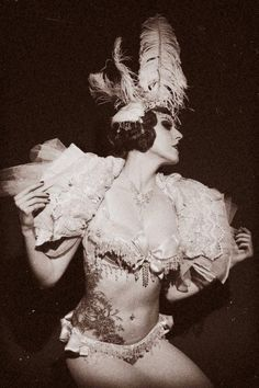 I believe this is a burlesque performer, if anyone knows who she is or the photographer let me know so I can credit them