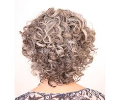 Pretty naturally grey curly hair, back.