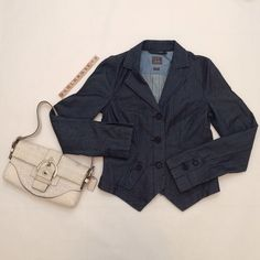 """Armani Exchange blue denim blazer/jacket Blue denim blazer, size M, overall length 21.5"""" (shortest part), 23.5"""" (longest part), 100% cotton, machine wash cold. 3 front buttons, 2 buttons on each sleeve, 2 front mini pockets each with a button. Brand new with tags so it's in excellent condition. No damage/fraying/stains. Has been m stored in a non-smoking/pet-free home. Handbag not included. No trades or PP. *15% off bundles of 2+ items!* A/X Armani Exchange Jackets & Coats Jean Jackets"""