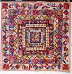 'V and A Postcard Quilt' by Jean Phillips and Andrew Whittle. This medallion quilt is made from over 10 years worth of Kaffe Fassett fabric scraps.  2014 Festival of Quilts (UK).  Photo by Fabadashery