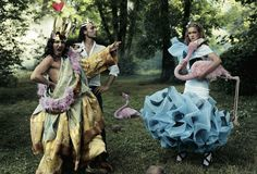 From left: John Galliano in Christian Dior Haute Couture, Alexis Roche, and Natalia Vodianova in a Fall 2003 cocktail dress with ruffled skirt. Photographed by Annie Leibovitz for Vogue, December 2003.