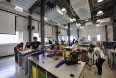 Undergraduates working on design and make projects in the Active Learning Laboratory. June 2012. University of Liverpool, School of Engineering. Architect unknown.