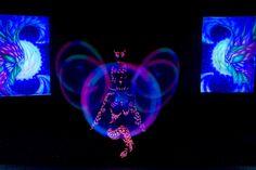 UV dancers Anta Agni - airbrush paintings and light props in black light show  http://antaagni.com/uv-light-show/