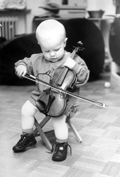 Child plays the violin like a cello by Gerd Pfeiffer - art print from King & McGaw