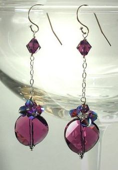 Amethyst Crystal Disco Earrings  by Michele Rose  Make this incredibly sparkly pair of earrings with Swarovski amethyst crystal 14mm twist bead focal pieces. The many facets and unusual twisted shape make this pair of earrings look like they are spinning. Six smaller Swarovski crystals add a bit more bling and even more movement to this playful pair of earrings.
