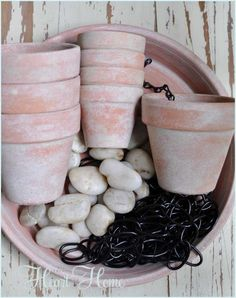 Rain Chain ~ DIY Rain Chains guide rain water down chain links making beautiful water displays.Make this one using chain, terra cotta pots and a saucer filled with pebbles. Garden Crafts, Garden Projects, Garden Art, Outdoor Projects, Plant Crafts, Garden Club, Herb Garden, Garden Design, Rain Chain Diy