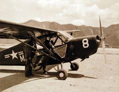 "Korean War: Aviation. A Marine ""Grasshopper"" used to observe artillery fire land to refuel at Marine VMO-6 air strip at Hoensong, Korea. Plane is piloted by Lieutenant A. W. Burre, USMC. Photographed by H.H. Searls, May 22, 1951. U.S. Navy photograph, now in the collections of the National Archives."