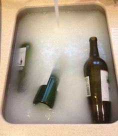 Fill your sink with hot, hot, hot water. Then fill each wine bottle with hot water and drop it into the sink. Next, add this secret potion: 1/2 cup baking powder 1 Tbsp dish soap 2 cups white vinegar Once you add the vinegar to the sink, it will get all fizzy for a second AND THE LABELS COME OFF! Good to know for wine bottle vases or other projects requiring an old bottle.