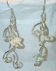 Check out this item in my Etsy shop https://www.etsy.com/listing/290358725/mix-matched-dangle-earrings-color-of-the
