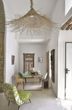 Dining rooms don't have to be formal or stuffy. We're all about a boho chic dining space, too! Check out these 40 dining rooms that master boho interior design. For more dining room design ideas, go to Domino! Rustic Style, Modern Rustic, Modern Farmhouse, Basket Lighting, Lighting Ideas, Lighting Design, Bamboo Lamp, Deco Nature, Interior And Exterior