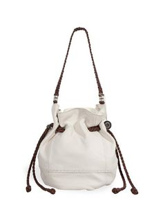 Our signature drawstring shape in soft textured leather.  Easy to wear with no fuss, features drawstring closure and tons of interior function.