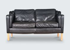 Fabulous 2-seater sofa in a thick buttery black leather with light beech legs. A matching 3-seater sofa is also available, each are sold separately. Price on application.