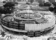 Aerial view of the Hirshhorn Museum and Sculpture Garden under construction, 15 August by Unidentified photographer, Photographic print, Smithsonian Institution Archives Record Unit 371 Box 4 Folder October Negative Number: Haunted House Film, Hirshhorn Museum, Round Building, Brutalist, Under Construction, All About Eyes, Aerial View, Modern Art, Architecture