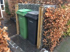 Lelijke vuilnisbakken wegwerken